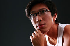 Portrait of a pensive asian man Stock Photo