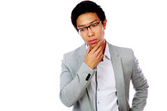 Portrait of a pensive asian man in glasses Stock Image