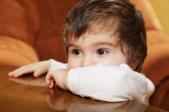 Portrait of pensive baby girl Stock Images