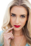 Portrait of a pensive blonde woman in blue dress looking at came Royalty Free Stock Photos