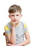 Portrait of a pensive boy Stock Photos