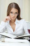 Portrait of pensive business woman in glasses Stock Photography