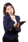 Portrait of pensive business woman. Young woman thinking, looking up, holding a clipboard pen on chin, isolated on white background stock images