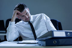 Portrait of pensive businessman in the office royalty free stock images