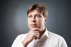 Portrait of pensive caucasian man Stock Photo