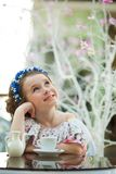Portrait of pensive child girl in a floral dress Royalty Free Stock Image