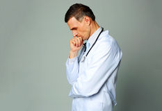 Portrait of a pensive doctor Royalty Free Stock Image