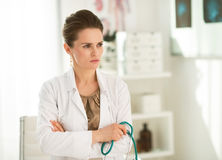 Portrait of pensive female doctor in the office Stock Photo