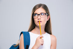 Portrait of a pensive female teenager holding pencil Stock Photography
