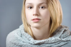 Portrait of pensive girl in gray pastel colors closeup Royalty Free Stock Photo