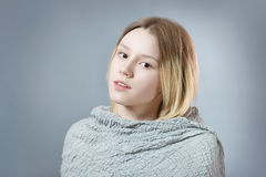 Portrait of pensive girl in gray pastel colors Royalty Free Stock Photos