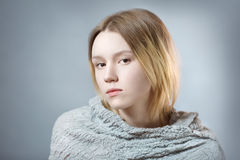 Portrait of pensive girl in gray pastel colors Stock Photo
