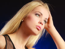 Portrait pensive girl long blond hair Stock Images