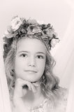 Portrait of a pensive girl with a wreath of flowers on her head Stock Photos