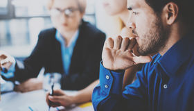 Portrait of pensive hispanic businessman on the business meeting with partners in modern office.Horizontal,blurred Royalty Free Stock Photos