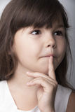 Portrait of a pensive little girl Stock Images