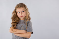 Portrait of pensive little girl isolated on a white background stock images