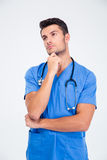 Portrait of a pensive male doctor Stock Image