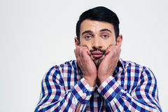 Portrait of a pensive man looking at camera Stock Images
