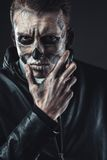 Portrait of pensive man with make-up  skull Royalty Free Stock Photo