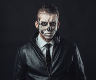 Portrait of pensive man with make-up skull stock image