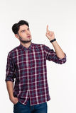Portrait of a pensive man pointing finger up Royalty Free Stock Image