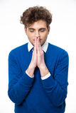 Portrait of a pensive man praying Royalty Free Stock Photos