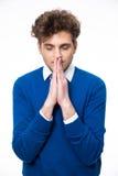 Portrait of a pensive man praying Royalty Free Stock Photos