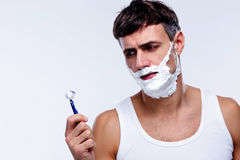 Portrait of a pensive man shaving Stock Photography