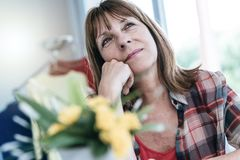 Portrait of pensive mature woman stock images