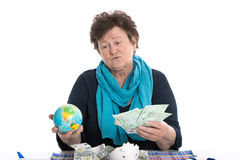 Portrait: Pensive older lady thinking about holidays - money con Stock Photo