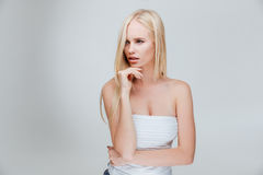 Portrait of a pensive pretty blonde girl thinking about something Stock Images