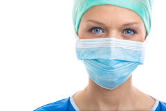 Portrait of a pensive/sad/exhausted female doctor/surgeon Royalty Free Stock Images