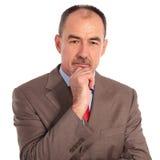 Portrait of a pensive senior businessman Stock Photos