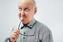 Portrait of a pensive senior man Stock Photography