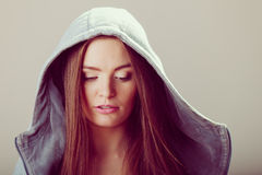 Portrait of pensive teenager girl in hood. Stock Photography