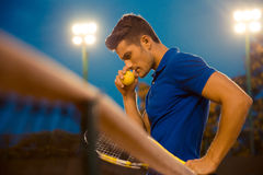 Portrait of a pensive tennis player Royalty Free Stock Image