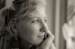 Portrait of a pensive woman in black and whote Royalty Free Stock Photo