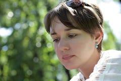 Portrait of pensive woman Stock Photos