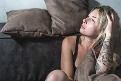 Portrait of a woman on the couch Royalty Free Stock Photos