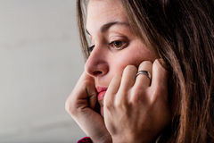 Portrait of a pensive woman Royalty Free Stock Photos