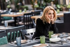Portrait of pensive woman waiting for someone. In restaurant Royalty Free Stock Photo