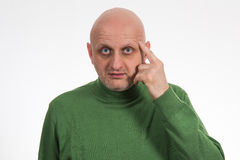 Portrait of a pensive young bald man Stock Image