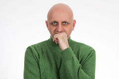 Portrait of a pensive young bald man.  Royalty Free Stock Photos