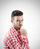 Portrait of pensive young bearded man looking at camera Stock Images