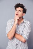Portrait of a pensive young man looking up Royalty Free Stock Photography