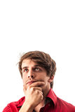 Portrait of pensive young man in red shirt isolated over white Stock Image