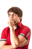 Portrait of pensive young man in red shirt isolated over white Royalty Free Stock Images