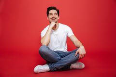 Portrait of a pensive young man in white t-shirt Stock Images