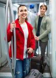 Portrait of people making acquaintance. Portrait of positive people making acquaintance in public transport stock photo